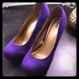 Purple faux suede pumps